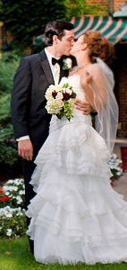 Bride & Groom kiss at our Lansing wedding venue